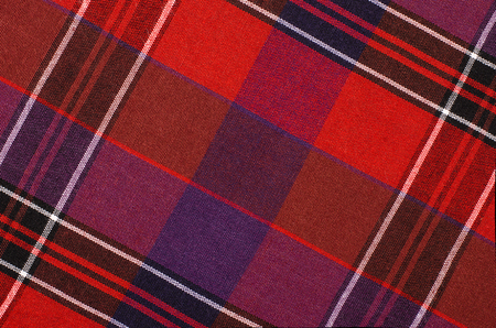 scottish: Scottish tartan pattern. Red and purple plaid print as background. Colored lines and square pattern. Scottish checked fabric.