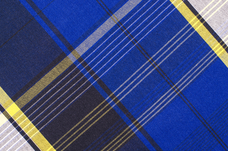 scottish: Scottish tartan pattern. Blue with yellow plaid print as background. Lines and square pattern. Scottish checked fabric. Stock Photo