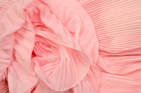 tulle: Close up on pink pleated lace. Pastel pink crumpled tulle as background.