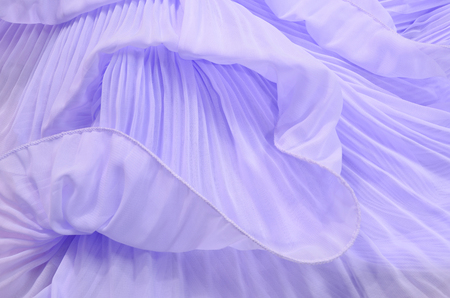 tulle: Close up on purple pleated lace. Pastel violet crumpled tulle as background.