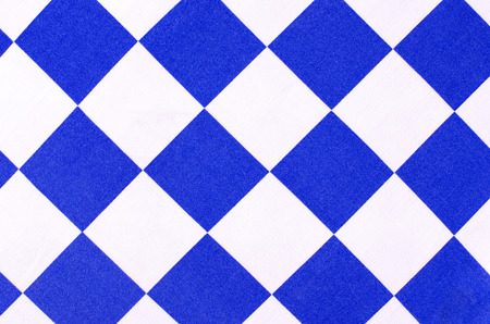 chequer: White and blue chequer  background. Checker diamond shape pattern on fabric.