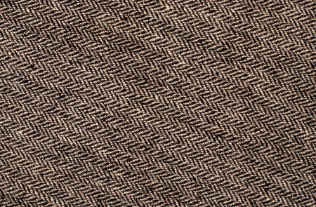close knit: Close up on tweed knit woolen texture. Brown woven thread as a background. Stock Photo