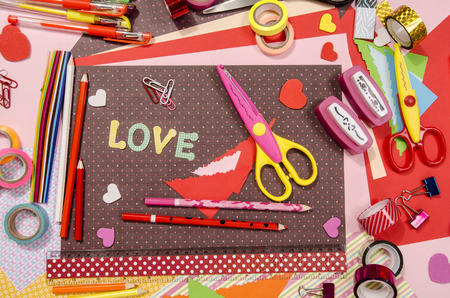craft supplies: Arts and craft supplies for Saint Valentines.  Color paper, pencils, different washi tapes, craft scissors, hearts supplies for decoration.