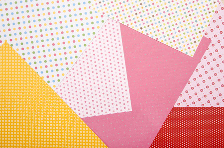 craft supplies: Color craft paper with different patterns.  Arts and craft supplies. Colorful paper background. Stock Photo