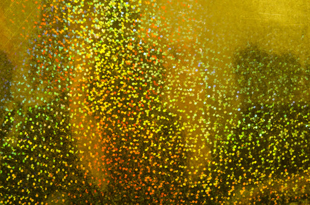 glitzy: Abstract gold glitter defocused background. Blurred shimmer bokeh. Holiday sparkle background.