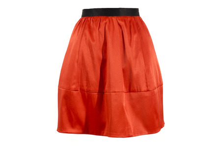 Orange skirt isolated on white background.  Festive short skirt with black waist band cut out on white.