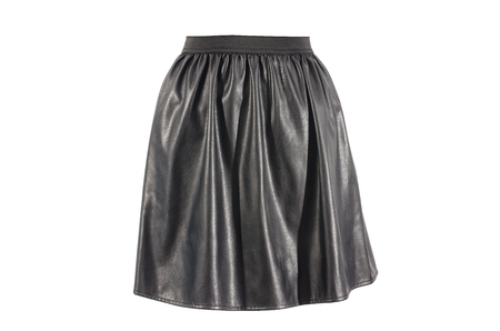 Black faux leather skirt isolated on white background. Vegan leather short skirt with elastic band cut out on white. Reklamní fotografie
