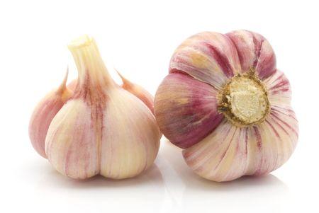 clove: two heads of fresh garlic on white background