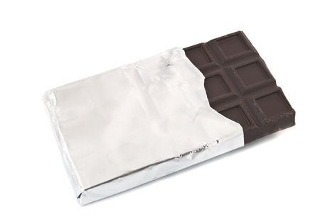 plain chocolate in silver foil isolated photo