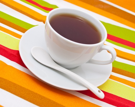 white cup of tea on striped cloth Stock Photo - 9739012