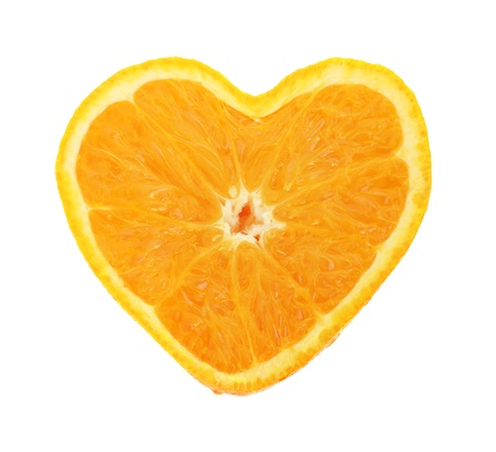 Orange cross section shaped like heart on white background