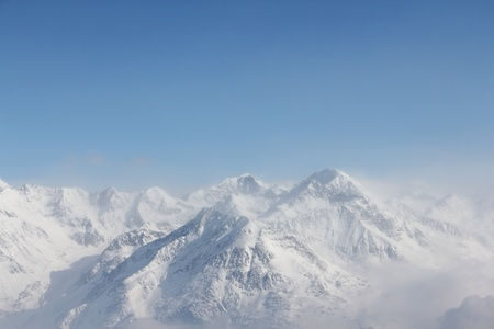 Winter alpine mountains covered with snow Stock Photo - 12464395