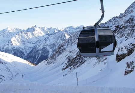 chairlift in beautiful winter snowy alpine mountains photo