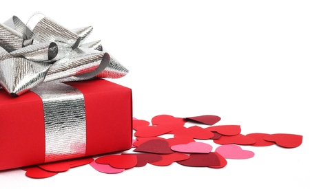 saint valentines: Valentines Day gift in red box and small hearts isolated on white Stock Photo
