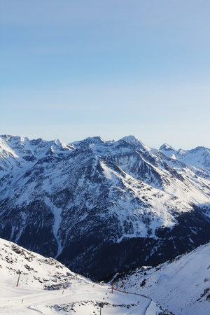 Winter alpine mountains covered with snow photo