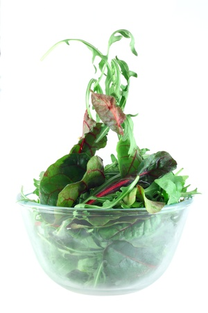 Rucola and Chard in bowl flying salad lightness concept