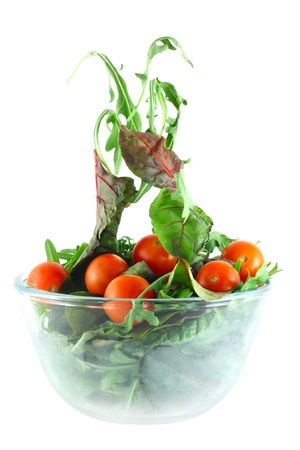 lightness: Rucola, Chard and cherry tomatoes in bowl flying salad lightness concept Stock Photo