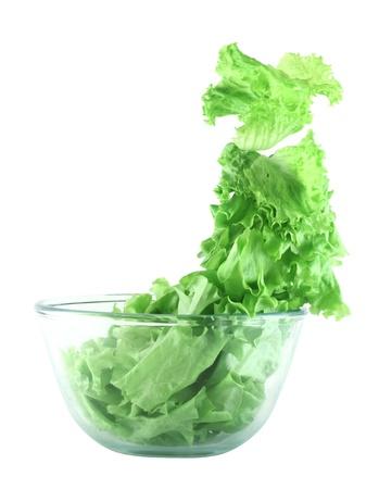 lightness:  Light lettuce salad in transparent bowl isolated on white lightness concept