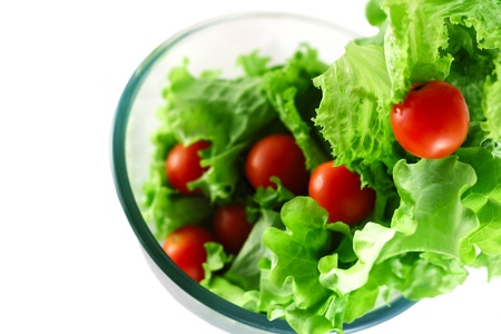 Light lettuce and cherry tomatoes salad top view isolated on white lightness concept photo