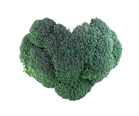Heart shaped broccoli isolated on white background photo