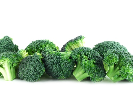 Fresh broccoli pieces in row isolated on white background