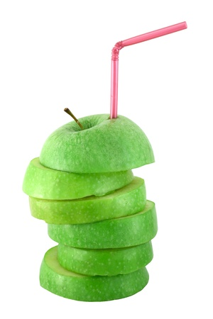 Stack of green  apple slices with straw juice concept isolated on white Stock Photo - 12908644