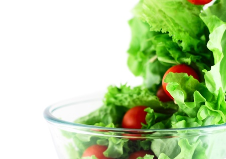 Light lettuce and cherry tomatoes salad close-up isolated on white lightness concept photo