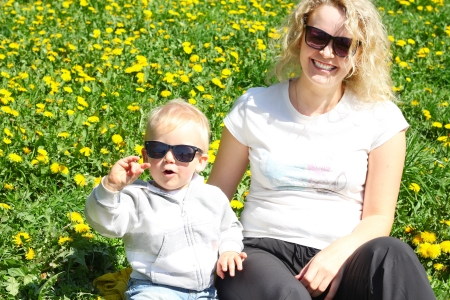 Funny mother and child wearing similar sunglasses Stock Photo