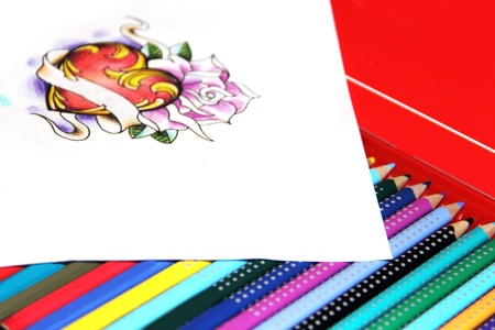 Drawing of tattoo with reart and rose on box with pencils Stock Photo - 13321990