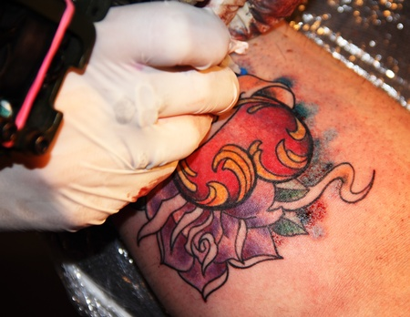 Making of colorful tattoo with heart rose and ribbon photo