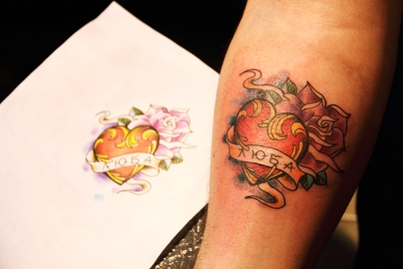 roses and blood: Finished fresh tattoo with sketch on paper