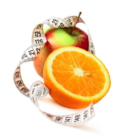 Orange half  apple and measure tape diet concept isolated on white corner composition Stock Photo - 13405618