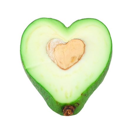 Cut avocado shaped like heart healthcare concept photo