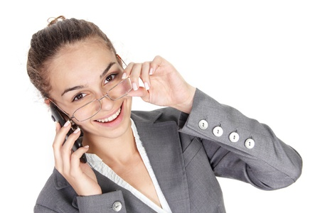 Young businesswoman with cell phone isolated on white background Stock Photo - 13978714