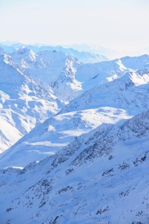 Beautiful panorama of mountain peaks in winter photo