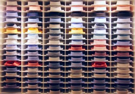 clothing store: Showcase with many colorful shirts on shelfs Stock Photo