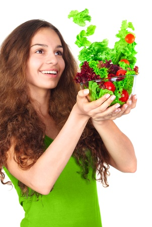 Woman with bowl of flying light salad diet concept photo