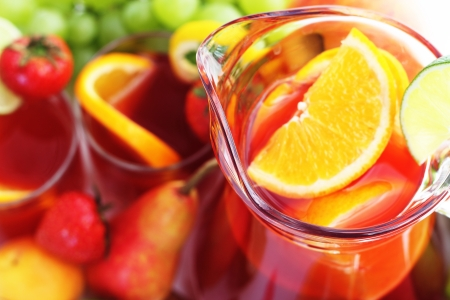 Refreshment beverage in pitcher with fruits  close-up background photo