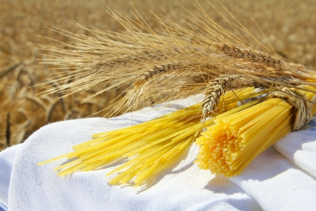 Spaghetti and wheat outdoors healthy eating concept Stock Photo