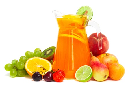 Fruit pile and juice in pitcher isolated on white background photo