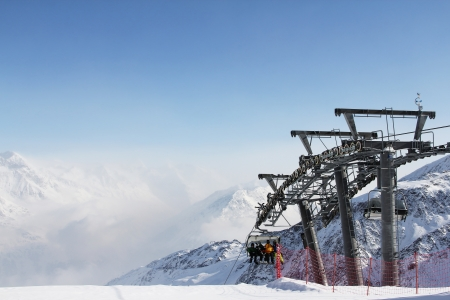 Chairlift in mountains and panoramic view on winter alps under blue sky Stock Photo - 15477740