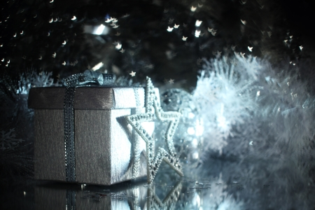 Silver christmas gift and different shiny decoration Stock Photo - 16297352