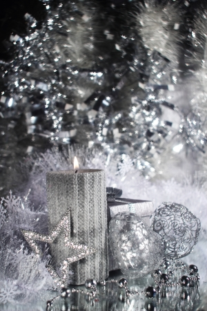 Christmas candle with gift and different silver decoration Stock Photo - 16297432