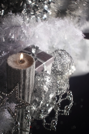 Christmas candle with gift and different silver decoration Stock Photo - 16297344