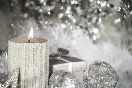 Christmas candle with gift and different silver decoration Stock Photo - 16297369