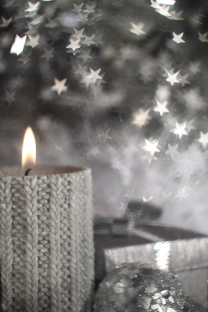 Christmas candle with gift and different silver decoration Stock Photo - 16297336