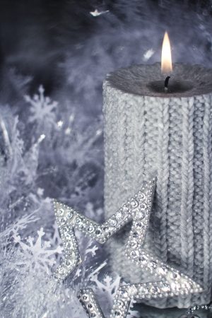 Christmas candle with gift and different silver decoration Stock Photo - 16297350