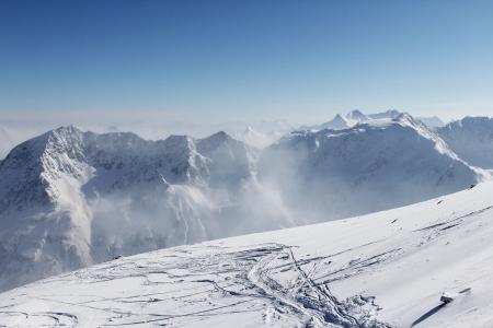 ski traces: Ski traces on snow in alps under blue sky Stock Photo