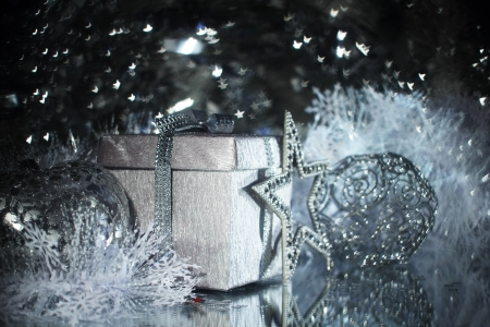 Silver christmas gift and different shiny decoration Stock Photo - 16505694