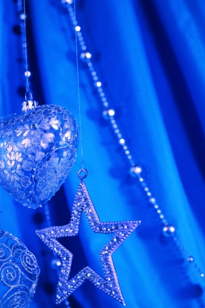 Blue christmas decoration on fabric background photo